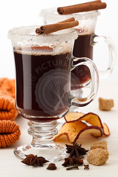 Two glasses of mulled wine on white background