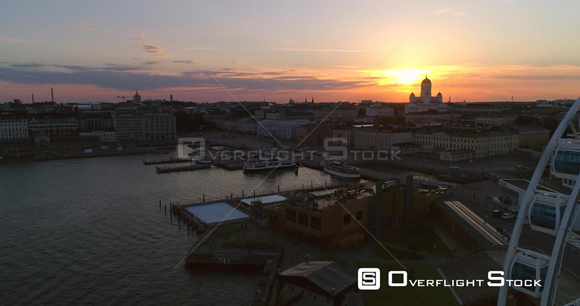Market Square, Aerial View Bypassing the Helsinki Skywheel, at the South Harbour, on a Sunny Summer Evening Dusk, in Helsinki...