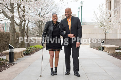 Woman with a prosthetic leg out for a walk on an overcast spring day