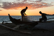 Fishermen handling their nets at sunset, Nosy Be, Madagascar