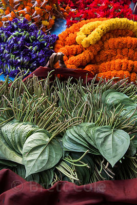 Betel leaves and garlands at the Howrah Flower Market, Kolkata, India.