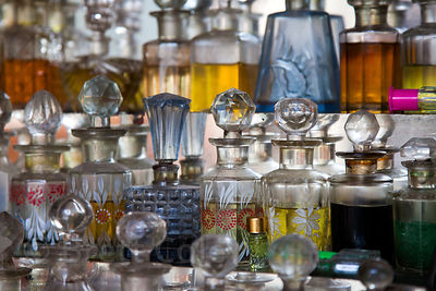 Dazzling display of glass perfume and oil bottles, Udaipur, Rajasthan, India