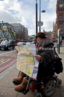 Female tourist in London using a power wheelchair