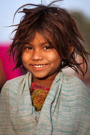 A girl poses for portraits at the Pushkar Camel Fair, Pushkar,  Rajasthan, India.