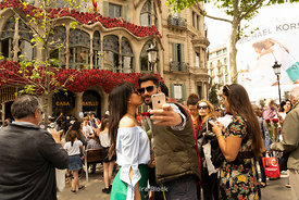Tourists taking selfies outside Casa Batllò built by the renowned architect Antoni Gaudí in Barcelona, Spain.