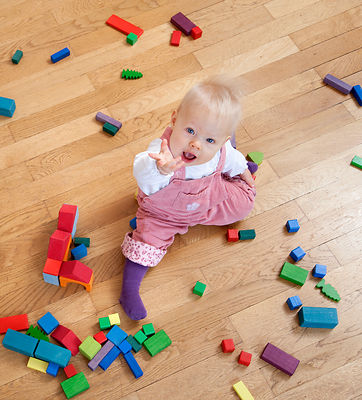 baby with toy building blocks