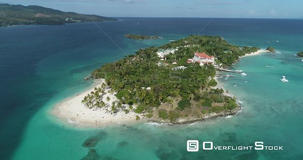 Small Caribbean island with palm trees. Flight traveling arround to the right. Callo Levantado, Samana, Dominican Republic