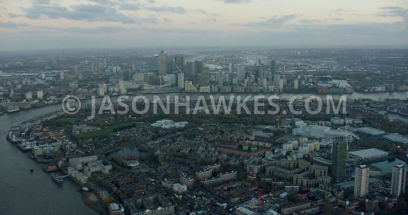 Aerial footage looking east over Rotherhithe to Canary Wharf