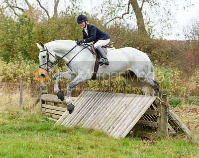 Juliet Cursham jumping a hunt jump near Peake's. The Cottesmore Hunt at Somerby