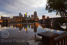 Minneapolis downtown at sunset with the Mississippi river on the foreground