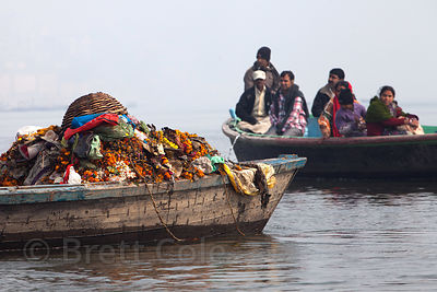 A garbage boat near Scindhia Ghat, Varanasi, India. It will be dumped directly into the Ganges River, including plenty of pla...