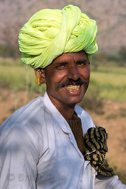 Farmer with a wonderful smile and tobacco stained teeth, Bir village, Rajasthan, India