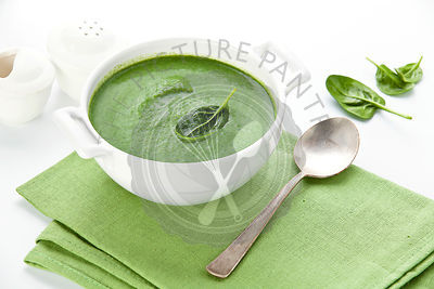 Spinach soup in white bowl