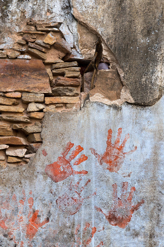 Hand prints on a temple wall, Budha Pushkar, Rajasthan, India