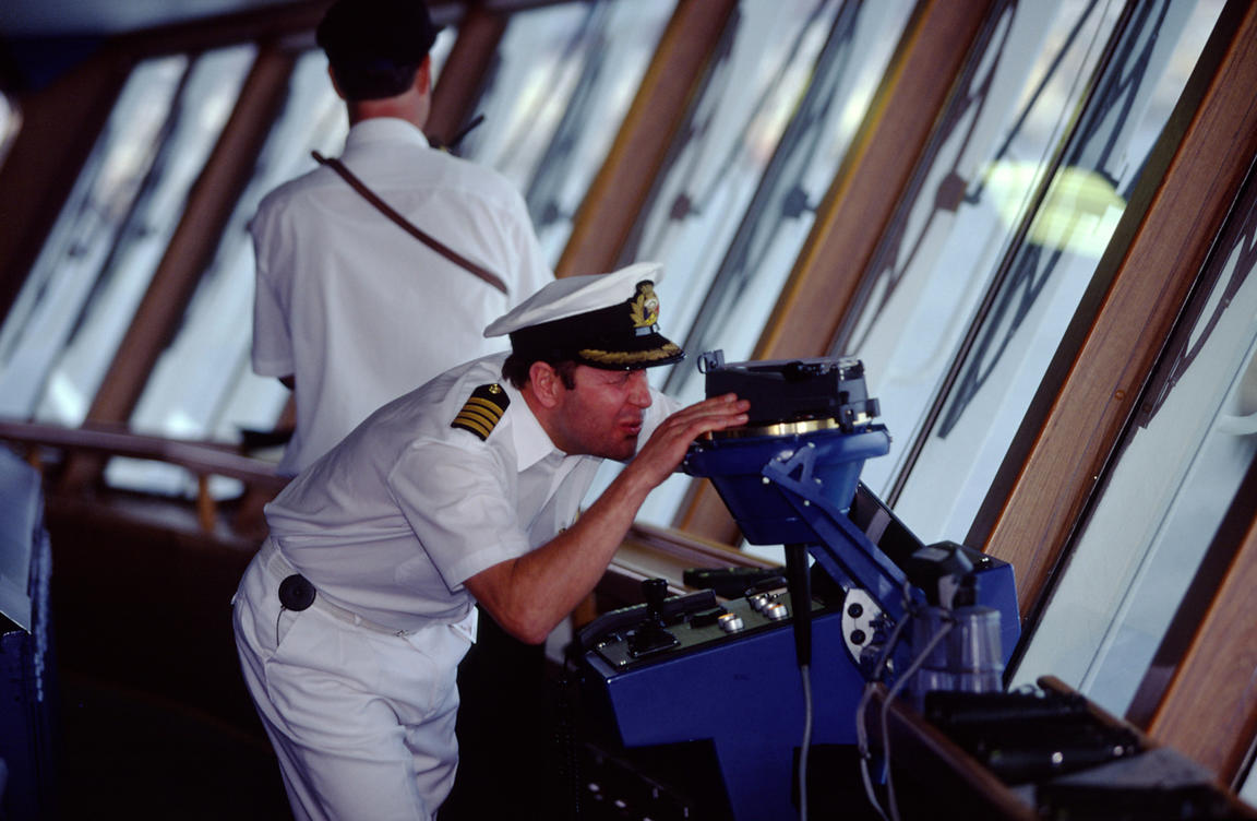 An officer of the crew on the bridge of the P&O liner Oriana checks his navigation equiptment