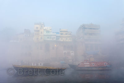 Heavy winter morning fog on the Ganges River, Varanasi, India.