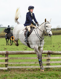 Lizzie Lomas jumping a hunt jump on Lambing's. The Cottesmore Hunt at Somerby