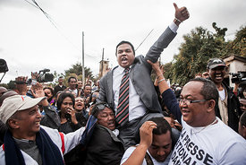Managing director of the newspaper Madagascar Matin Jean-Luc Rahaga (C) is lifted by supporters after his release from Antani...