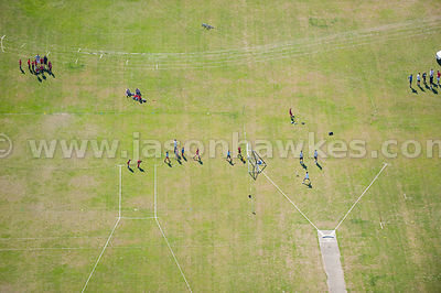 Aerial view of children and families playing sports
