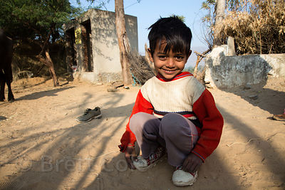 Farm boy on a winter morning in the desert, Chawandiya village, Rajasthan, India