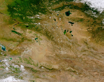 EARTH Central Asia -- The rugged and remote Altai Mountains (running diagonally from the upper left to lower right of the ima...