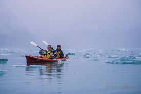 Kayakers in Ice and Mist