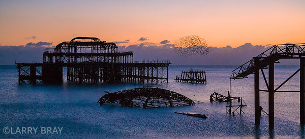 West Pier in soft sunset in Brighton, East Sussex, UK