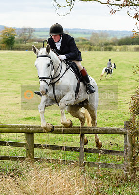 Dick Wise jumping onto Bruce's Lane. The Cottesmore Hunt at Somerby