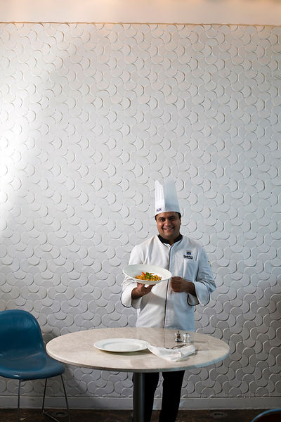 India - Delhi - Head chef at the Park Hotel, Anurudh Khanna prepares a dish of shahi paneer in the kitchens