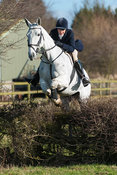 Fiona Gibson jumping the first hedge from the meet