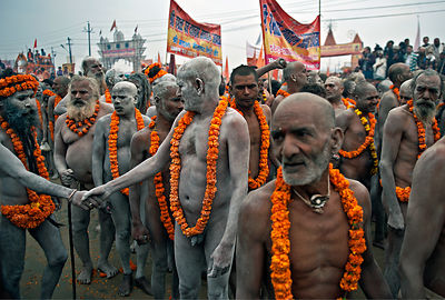 Two naga saints greet each other during the Kumbh Mela
