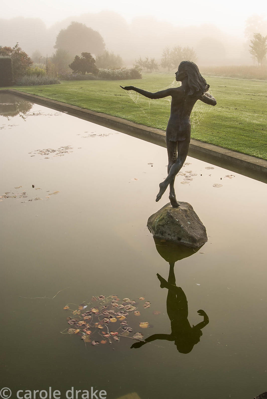 'Miranda' by Tanya Russel at the head of the water lily canal. Waterperry Gardens, Wheatley, Oxfordshire, UK