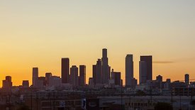 Wide Shot: Neighborhood Rooftops In Front Of Downtown L.A. Skyline (Day to Night)