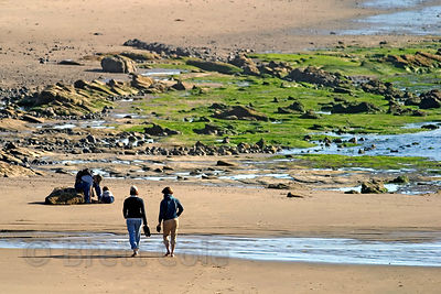 Visitors stroll along the beach near Seal Rock, Oregon Coast.