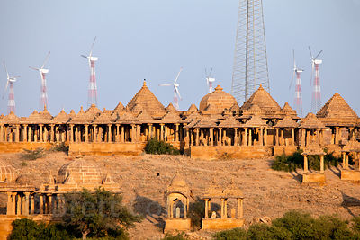 Electricity-generating windmills behind the Bada Bagh cenotaphs in Jaisalmer, Rajasthan, India