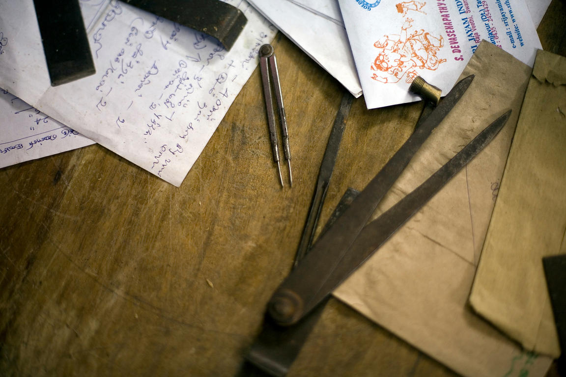 India - Swamimalai - Calipers and measurements on a desk in the studio of the Stpathy family of idol makers