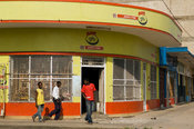 Mozambique, Beira, Corner shop with curved facade with art-deco influence.