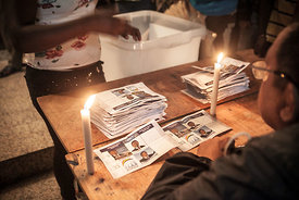 Electoral agents count votes at a polling station in Antananarivo on December 20, 2013, as the people of Madagascar elect a n...