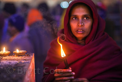 A woman prays at the Kapil Muni temple at the Gangasagar Mela, Sagar Island, India.