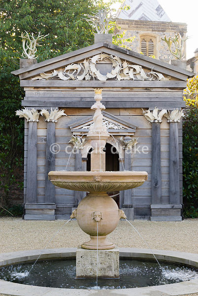 Upper terraces in the Collector Earl's Garden feature fountains with dogs' head spouts, and a temple decorated with deer antl...