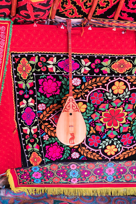 A dombra, a traditional Kazakh musical instrument hanging in a ger or yurt in Ölgii, the capital of the Bayan-Ölgii Aimag of ...