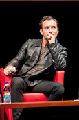 Jude Law appearing on stage in conversation at the 10th Rome Film Festival
