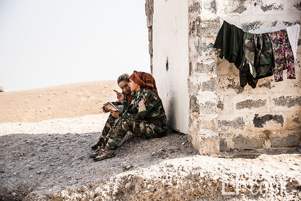 PAK (Kurdistan Freedom Party) female fighters, taking some time out to read, at their base north of Hawija, where Kurdish Ira...