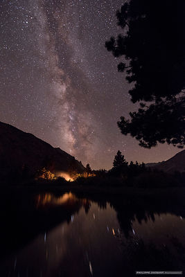Camp fire beneath Milky Way - Intake 2 lake - California