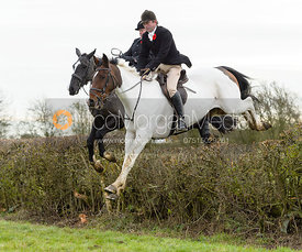 Jamie Collie jumping a hedge on Graham Smith's