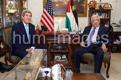 U.S. Secretary of State John Kerry meets with Palestinian Authority President Mahmoud Abbas in Amman, Jordan, on November 13,...