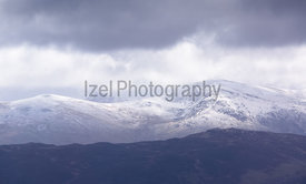 A snow covered Helvellyn from Grisedale Pike in the Lake District.