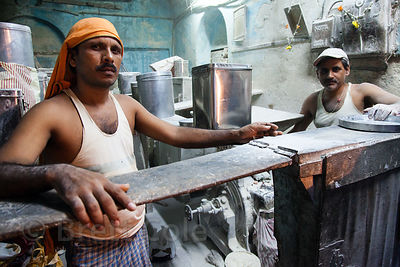 Men working in a small flour mill in  in Bandra East, Mumbai, India.