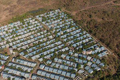 Aerial view of a densely populated subdivision of housing from the city of Manila, Philippines, April 2010