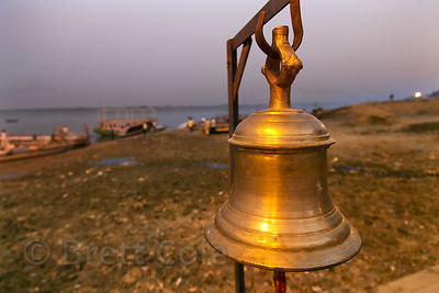 Brass bell on the Ganges River, Assi Ghat, Varanasi, India